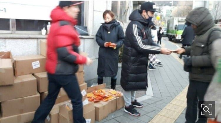 Super Junior's Kangin Spotted Giving Out Food To Protesters At Gwanghwamun Square