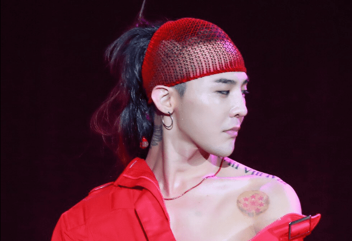 WATCH: G-Dragon Keeps Performing Despite Fan Jumping Onstage To Hug Him