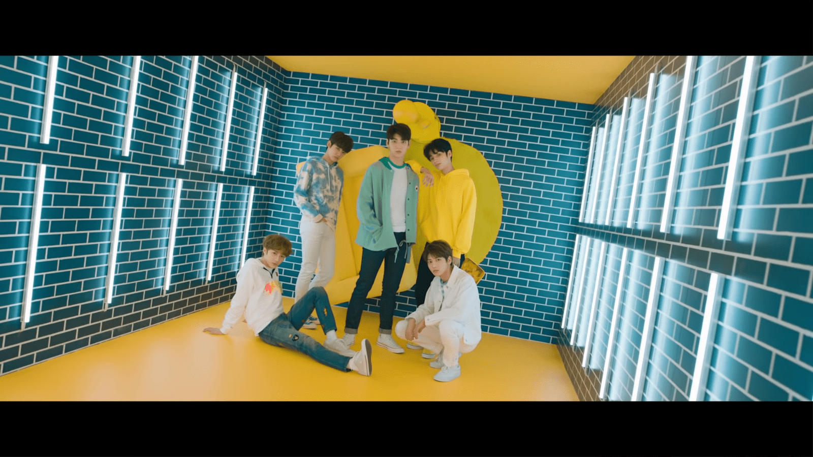 "WATCH: Big Hit's New Boy Group TXT Makes Debut With Colorful ""CROWN"" MV"