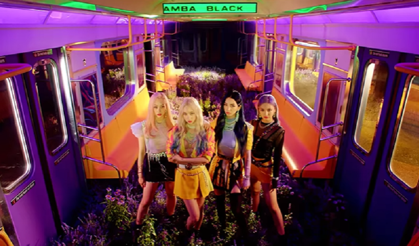 "WATCH: Aespa Introduces A Digital Fantasy World In ""Black Mamba"" Debut MV"